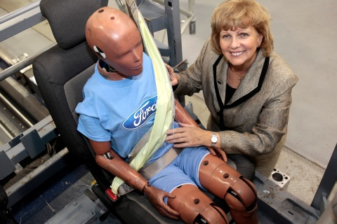 Ford Motor Vice President, Sustainability, Environment and Safety Engineer Sue Cischke shows a crash test dummy strapped in a Servo Sled Crash Simulator wearing seat belt air bags in Dearborn,