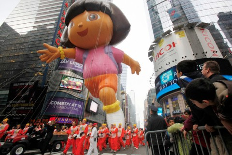 A Dora the Explorer balloon makes its way across 4nd street during the Macy's Thanksgiving Day Parade in New York