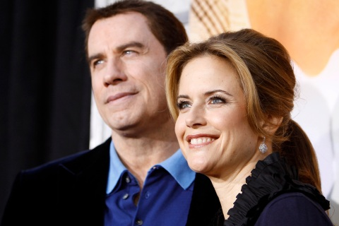 "Preston and her husband Travolta pose at the premiere of ""The Last Song"" at the Arclight theatre in Hollywood"