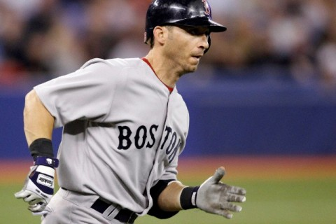 Red Sox batter Marco Scutaro watches his double during their MLB American League baseball game in Toronto