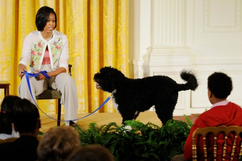 Bo and Michelle Obama attend an event to welcome children of White House employees to the White House in Washington