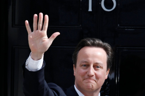 Britain's Prime Minister Cameron waves outside 10 Downing Street in London