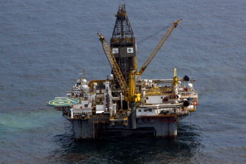 The Transocean Development Driller III, which is drilling the relief well, is seen surrounded by part of the oil slick covering the site of the BP oil spill in the Gulf of Mexico