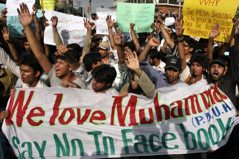Pakistani students hold a banner during a May 19 protest against Facebook