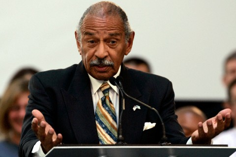 U.S. Representative Conyers addresses the audience during a program to announce the first round of loan commitments in Dearborn