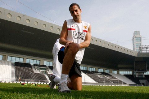 Manchester United's Rio Ferdinand stretches during a training session at Al-Sadd club in Doha