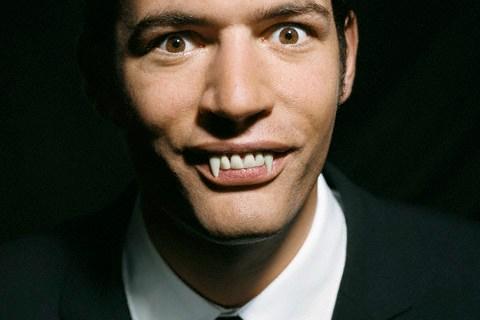 Businessman with Vampire Teeth
