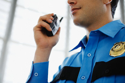 Police Officer Using Walkie-Talkie