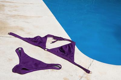 Bikini by swimming pool