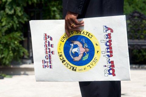 USA - Politics - President Obama Holding Birthday Card