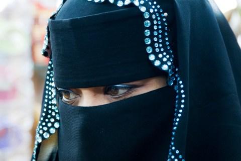 Woman at the incense market (souk)