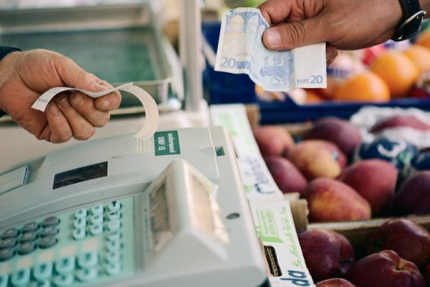 Customer Paying at Market