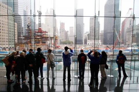 People look over the site of the former twin towers on the eighth anniversary of the attacks on the World Trade Center in New York