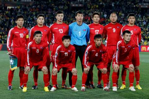 North Korea's players pose for a team photo at a 2010 World Cup Group G soccer match against Brazil at Ellis Park stadium in Johannesburg