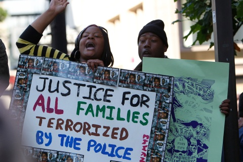 Demonstrators gather in Oakland, California to protest the verdict on the case of BART officer Mehserle