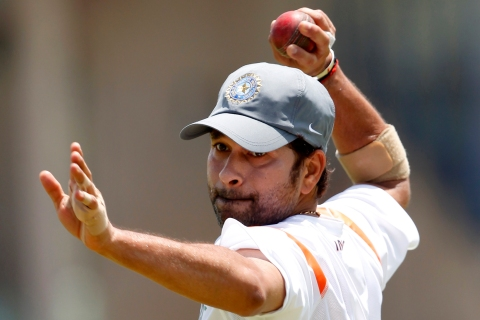 India's Tendulkar prepares to throw a ball during a practice session in Galle