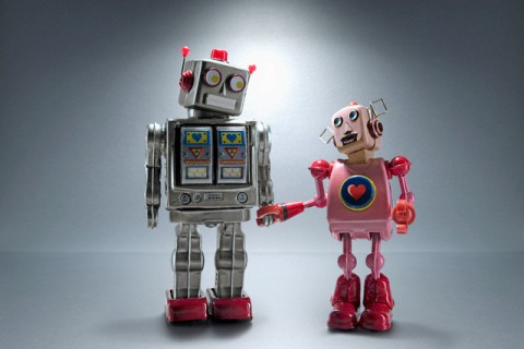 Robot couple holding hands