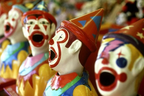 Row of Clown Heads for Side-show Alley Game at Funfair