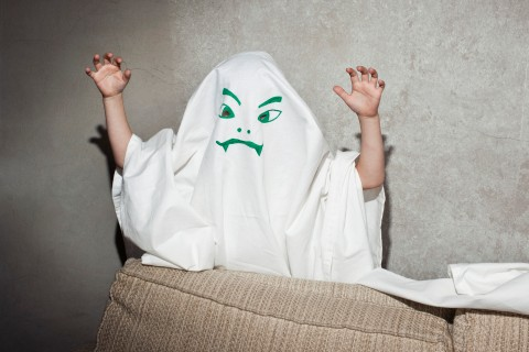 Little kid dressed as a ghost