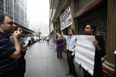 Demonstrators in support of the proposed Muslim cultural center and mosque Park51 discuss issues with pedestrians passing by in front of the property in New York