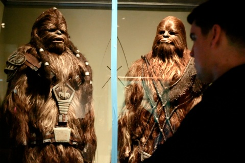 Exhibit designer Horvath looks at two Wookies from the Star Wars movies in Boston.