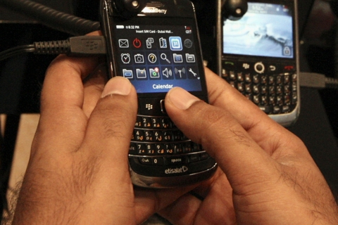 A man tests a BlackBerry phone at a shopping mall in Dubai