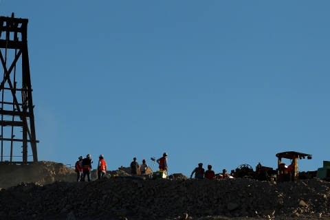 A work team prepares the land where a special drill which will dig an escape hole for the 33 miners who are trapped underground in a copper and gold mine will be used in Copiapo