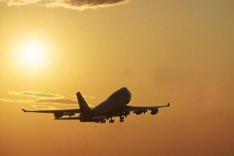 Boeing 747s Jumbo Jet Taking Off at Sunset