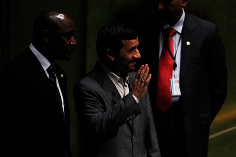 Iran's President Mahmoud Ahmadinejad waves before speaking during the Millennium Development Goals Summit at the U.N. headquarters in New York
