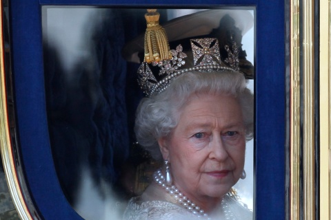 Britain's Queen Elizabeth leaves Buckingham Palace in a horse drawn carriage.