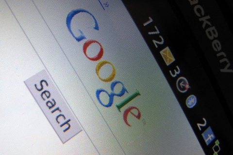 A Google Inc page is shown on a blackberry phone in Encinitas