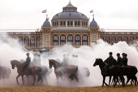 Members of the Dutch Royal guard of honour rehearse ahead of the Dutch 2011 budget presentation on the beach at Scheveningen