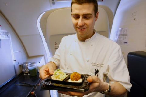 Executive Chef David Deshaies prepares Onion Carbonara by renowned chef Michel Richard aboard one of Openskies Airlines Boeing 757-200 jets that features business class only cabins at Washington Dulles International Airport
