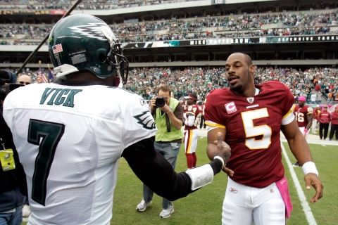 Redskins quarterback McNabb is greeted by Eagles quarterback Vick before the start of their NFL football game in Philadelphia Pennsylvania
