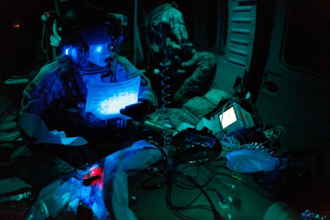 U.S. flight medic treats an unconscious fellow U.S. serviceman during a night time emergency airlift in southern Afghanistan