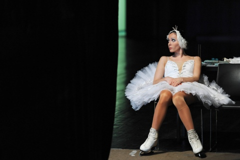 A dancer of the Saint-Petersburg State Ice Ballet of Russia waits backstage before a performance of the Swan Lake at a theatre in Hefei