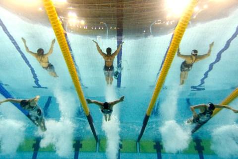 China's Ji Liping, Japan's Satomi Suzuki and South Korea's Jeong Da-rae swim their women's 100m breaststroke final at the 16th Asian Games in Guangzhou
