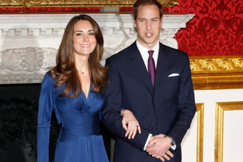 Britain's Prince William and his fiancée Kate Middleton pose for a photograph in St. James's Palace in central London