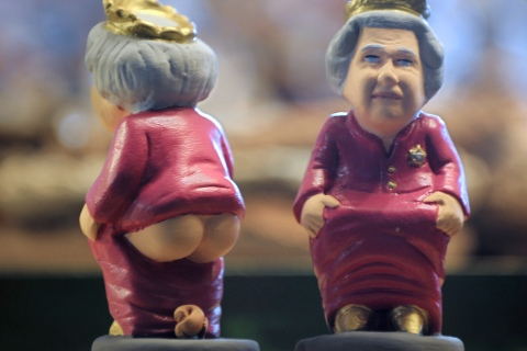 A ceramic figurine called a 'caganer' of Britain's Queen Elizabeth at the Santa Llucia Fair in Barcelona