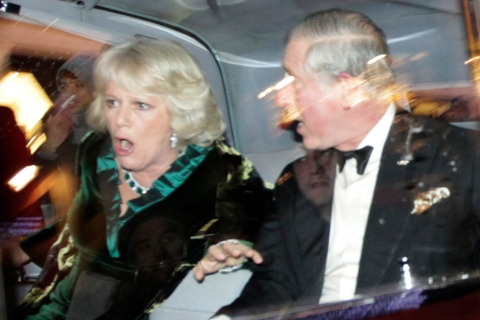 Prince Charles and Camilla, Duchess of Cornwall, react as their car is attacked by angry protesters in London