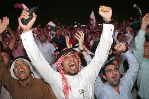 Qatari fans celebrate at Aspire Park in Doha after the announcement that Qatar will host the 2022 World Cup