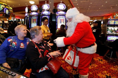 Santa hands out gifts in a casino