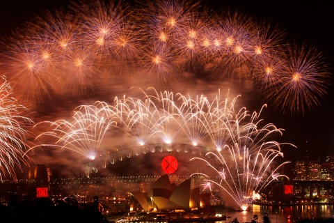 Fireworks explode over the Sydney Harbour Bridge and Opera House during a pyrotechnic show to celebrate the New Year 2011