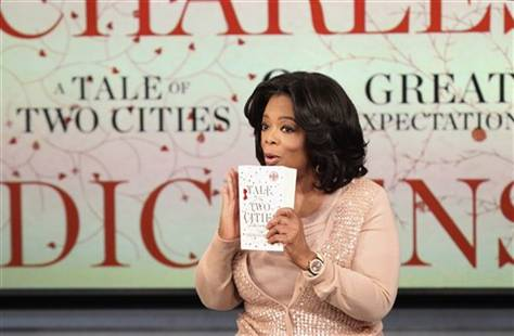 """Oprah Winfrey announcing her book club selections, """"A Tale of Two Cities"""" and """"Great Expectations"""" by Charles Dickens"""