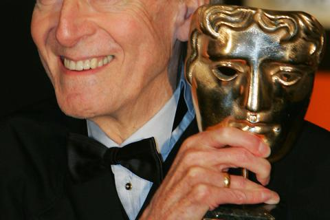 British composer John Barry poses with t