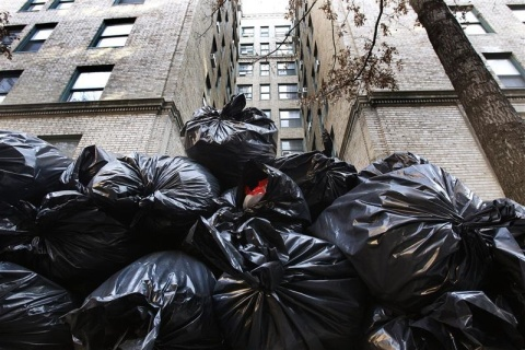 Garbage bags which broke the fall of a would-be suicide jumper are seen piled up outside 325 West 45th Street in New York