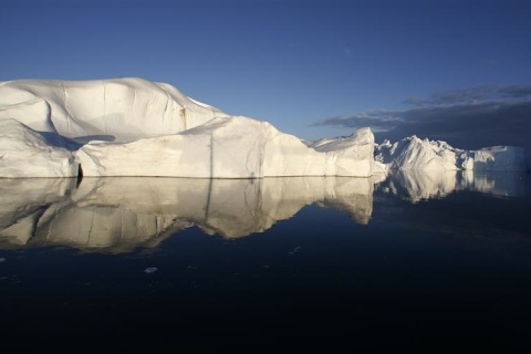 File photo of icebergs reflected in the calm waters at the mouth of the Jakobshavn ice fjord near Ilulissat