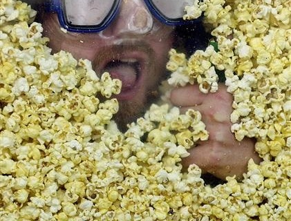 MAN TRIES TO EAT WEIGHT IN POPCORN IN NEW YORK.