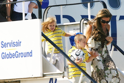 David and Victoria Beckham and family arrive at Stansted airport near London