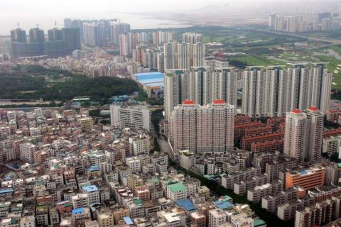 - FILE PHOTO TAKEN 24MAY06 - An aerial view shows high-rise residential buildings in China's souther..